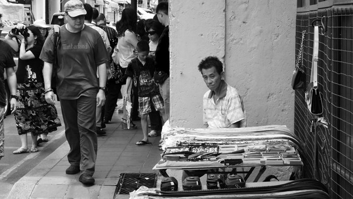 Seller and passing by