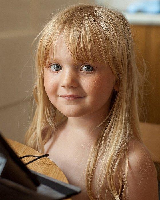 Little Tayla in the window light